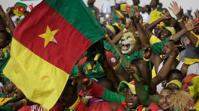 Cameroon supporters chants ahead of soccer match against Guinea Bissau during the African Cup of Nations Group A soccer match between Cameroon and Guinea Bissau at the Stade de l'Amitie, in Libreville, Gabon, Jan. 18, 2017.