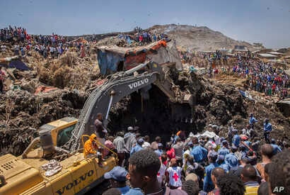 FILE - Rescuers work at the scene of a garbage landslide, on the outskirts of Addis Ababa, Ethiopia, March 12, 2017. A cause still has not been determined.