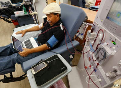FILE - A patient undergoes dialysis at a clinic in Sacramento, Calif., Sept. 24, 2018. Of the eight initiatives on California's Tuesday ballot, the costliest thus far is Proposition 8, a measure that would cap profits for dialysis clinics.
