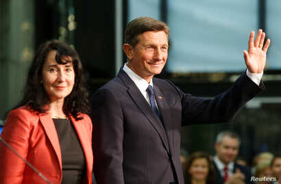 President Borut Pahor and his wife, Tanja Pecar, react after first results of the second round of the presidential elections in Ljubljana, Slovenia, Nov. 12, 2017.