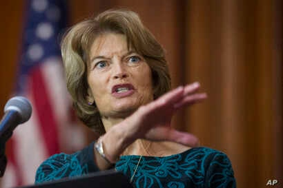 Sen. Lisa Murkowski, R-Alaska, speaks after an order withdrawing federal protections for countless waterways and wetland was signed, at EPA headquarters in Washington, Dec. 11, 2018.