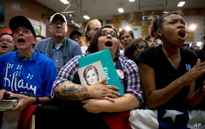 Supporters call out as Democratic presidential candidate Hillary Clinton speaks during a campaign event at Carl Hayden Community High School in Phoenix, Arizona, March 21, 2016.