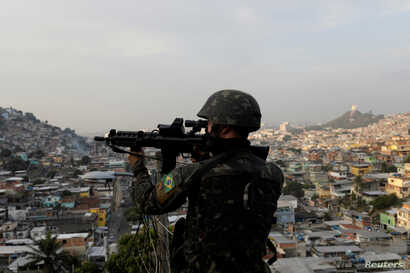 A Brazilian soldier patrols at Chatuba slum during an operation against drug dealers in Rio de Janeiro, Brazil, Aug. 22, 2018.