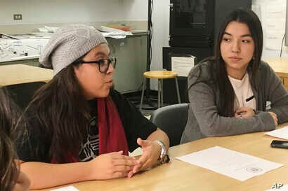 In this photo taken Dec. 1, 2016, Mexican students Yatziri Tovar, left, and Roxanna Herrera, discuss their travel plans at City College of New York.