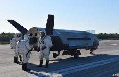 This image provided by the U.S. Air Force shows the Air Force's X-37B spacecraft at NASA's Kennedy Space Center Shuttle Landing Facility in Cape Canaveral, Fla., Sunday, May 7, 2017.