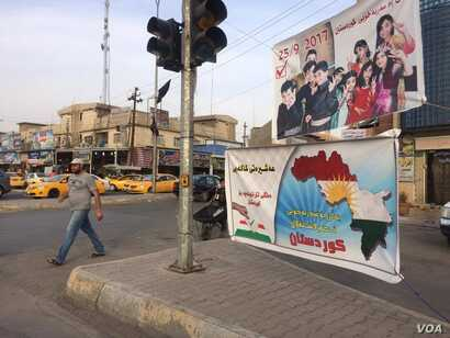 Some people in minority groups in Kirkuk say they didn't vote in the independence referendum promoted in this sign because they believed the issue to be a Kurdish one on Sept. 26, 2017 in Kirkuk. (Photo: H. Murdock / VOA)