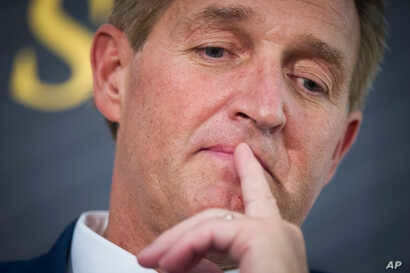 FILE - In this Oct. 2, 2018 file photo Sen. Jeff Flake, R-Ariz. participates in an interview at the The Atlantic's 'The Constitution in Crisis' forum in Washington.