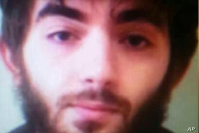 This undated photo made available to the Associated Press on condition that its source not be revealed, allegedly shows Khamzat Azimov, the suspect in the Paris knife attack.