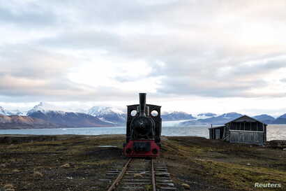 An old locomotive train that was used for transporting coal is preserved as a monument at Ny-Alesund, in Svalbard, Norway, Oct. 11, 2015.