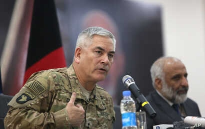 General John Campbell, left, commander of U.S. and NATO forces in Afghanistan, and Afghan acting Defense Minister Masoom Stanekzai hold a press conference at the Afghan Defence ministry in Kabul, Feb. 7, 2016.