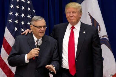 FILE - Republican presidential candidate Donald Trump is joined by Maricopa County, Ariz., Sheriff Joe Arpaio at a campaign event in Marshalltown, Iowa, Jan. 26, 2016.