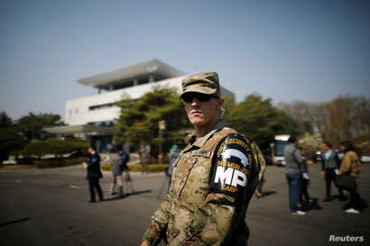 A U.S. Army soldier stands guard in front of the Peace House at the truce village of Panmunjom inside the demilitarized zone separating the two Koreas, South Korea, April 18, 2018.