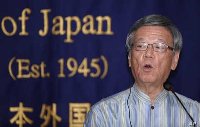 FILE - Okinawa Gov. Takeshi Onaga speaks at the Foreign Correspondents' Club of Japan in Tokyo, May 20, 2015. Onaga, who died of cancer Wednesday, had spearheaded said opposition to the base.