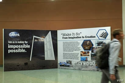 """A conference visitor passes a display evoking a """"Star Trek"""" future. The science-fiction show's hand-held medical scanners don't exist (yet), but """"near-instant diagnostic tests for Ebola and other diseases do,"""" thanks to technologies devel..."""