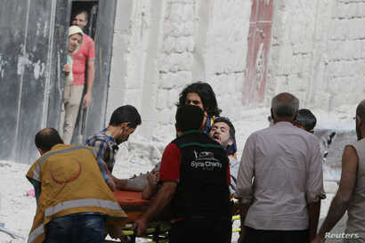 A man reacts while being carried on a stretcher after airstrikes on the rebel held al-Qaterji neighbourhood of Aleppo, Syria, September 21, 2016.
