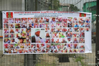 FILE - A poster displaying wanted Boko Haram suspects is seen on a street in Yenagoa in Nigeria's delta region, May 19, 2016.