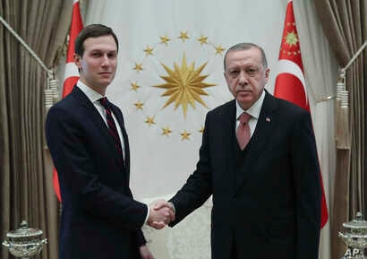Turkey's President Recep Tayyip Erdogan shakes hands with Jared Kushner (L), U.S. President Donald Trump's adviser, prior to their meeting at the Presidential Palace in Ankara, Turkey, Feb. 27, 2019.
