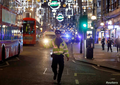 A police officer walks along Oxford Street, in central London, Britain, Nov. 24, 2017.