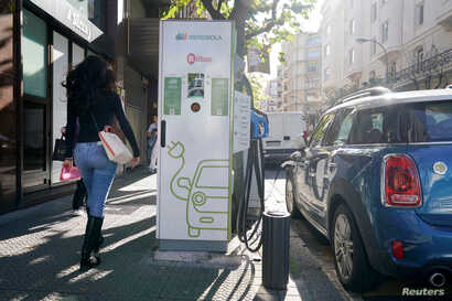 An electric car is charged from an Iberdrola electric car charging station in central Bilbao, Spain, Nov. 15, 2018.