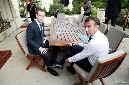 """FILE - Facebook's founder and CEO Mark Zuckerberg meets with French President Emmanuel Macron at the Elysee Palace after the """"Tech for Good"""" summit, in Paris, France, May 23, 2018."""