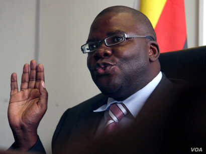 FILE: Zimbabwe's new finance minister Tendai Biti talks at a news conference in Harare Wednesday Feb. 18, 2009. Biti, now in charge of the country's finances said  he had started paying civil servants in U.S. dollars, pledging to get a country crippl...