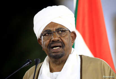 FILE PHOTO: Sudanese President Omar al-Bashir delivers a speech at the Presidential Palace in Khartoum, Feb. 22, 2019.