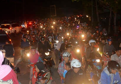 Motorists are stuck in traffic as they try to reach higher ground amid fears of a tsunami, following an earthquake in Cilacap, Central Java, Indonesia, Dec. 16, 2017.