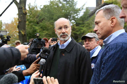 Pennsylvania Governor Tom Wolf and Wendell Hissrich, right, Pittsburgh public safety director, speak to media, after a gunman opened fire at the Tree of Life synagogue in Pittsburgh, Pa., Oct. 27, 2018.