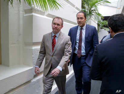 Budget Director Mick Mulvaney, left, with Rep. Will Hurd, R-Texas, a member of the House Intelligence Committee, leaves a meeting with President Donald Trump at the Capitol in Washington, March 21, 2017.