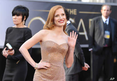 Jessica Chastain arrives at the 85th Academy Awards at the Dolby Theatre on Sunday Feb. 24, 2013, in Los Angeles.