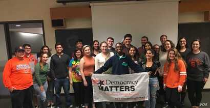 Political science student Cassie Cleary stands in the middle of a group of her fellow members of Syracuse University's chapter of Democracy Matters.