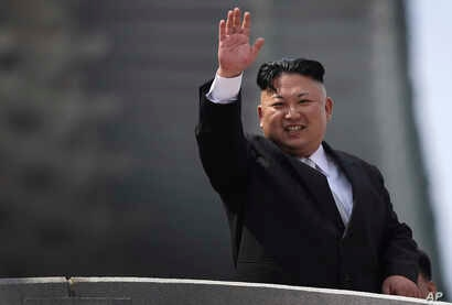 North Korean leader Kim Jong Un waves during a military parade, April 15, 2017, in Pyongyang, North Korea to celebrate the 105th birth anniversary of Kim Il Sung, the country's late founder and grandfather of current ruler Kim Jong Un.