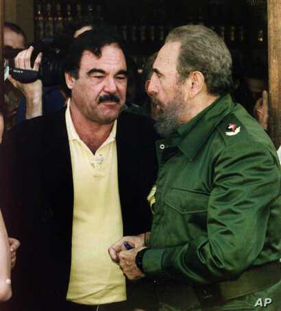 "FILE - Director Oliver Stone and Cuban leader Fidel Castro, Feb. 21, 2002, after wrapping up shooting of a documentary in Ernest Hemingway's preferred bar ""La Terraza"" in Cojimar near Havana, Cuba. The producer and others involved in Stone's document..."