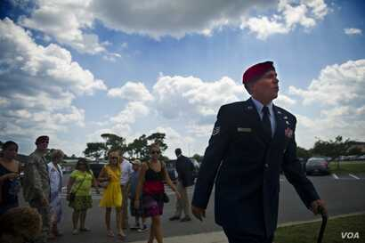 FILE - U.S. Air Force Staff Sgt. Johnnie Yellock walks with a cane to his Bronze Star Medal ceremony, at Hurlburt Field, Florida, June 26, 2012. Yellock received the Bronze Star for his deployment to Afghanistan in 2011 during which was seriously inj...