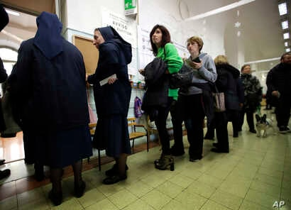 People line up at a polling station near the Vatican, in Rome, March 4, 2018.
