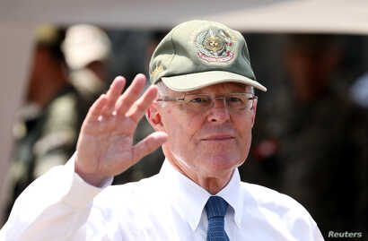 Peru's then-president, Pedro Pablo Kuczynski, participates in a military event at Rimac army headquarters in Lima, March 20, 2018.