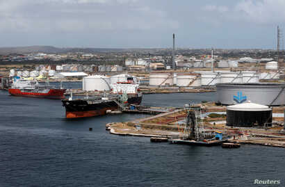 Crude oil tankers are docked at Isla Oil Refinery PDVSA terminal in Willemstad on the island of Curacao, Feb. 22, 2019.