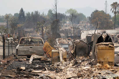 A charred neighborhood destroyed by the Carr Fire is seen west of Redding, California, July 27, 2018.