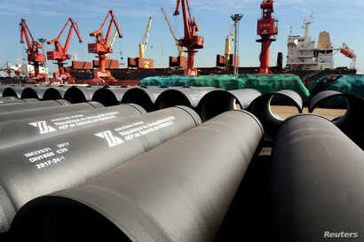 FILE - Steel pipes to be exported are seen at a port in Lianyungang, Jiangsu province, China, May 31, 2018.