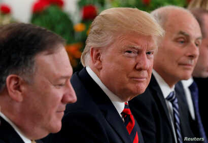 U.S. President Donald Trump flanked by Secretary of State Mike Pompeo and White House Chief of Staff John Kelly attend a lunch with Singapore's Prime Minister Lee Hsien Loong and officials at the Istana in Singapore, June 11, 2018.