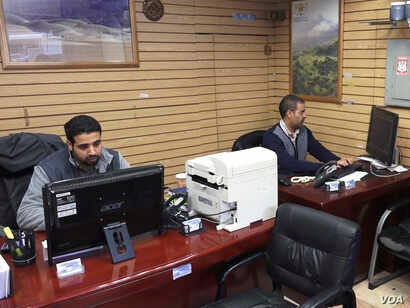 Travel agent Waddah Mubarez (right) says bookings among Yemenis have been down by more than 50% over the past year. But his biggest concern is being separated from his mother, who cannot travel to the United States due to travel restrictions placed o...