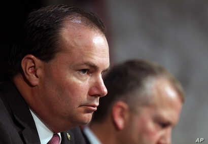 Sen. Mike Lee, R-Utah, listens during a Senate Armed Services Committee on Capitol Hill in Washington, July 21, 2015 .
