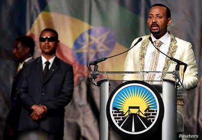 FILE - Ethiopia's Prime Minister Abiy Ahmed addresses his country's diaspora, the largest outside Ethiopia, calling on them to return, invest and support their native land. He spoke in Washington, July 28, 2018.