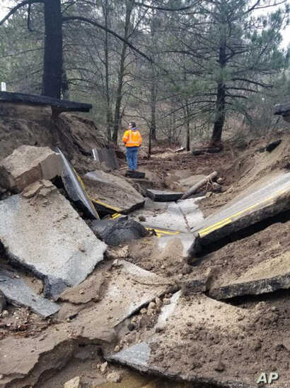 bout 75 feet (23 meters) of pavement in the San Jacinto Mountains collapsed near Idyllwild, Calif., Feb. 15, 2019, from storms. Rainwater continues to drain Friday from California's saturated landscapes, and road crews in parts of Colorado, Montana a...