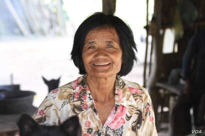 """Seum Yun, 63, is the chief of Sovong village and has been tasked with registering residents for the CPP family book. """"We don't know if they feel pressure or not, but we don't force them to sign,"""" she said, Nov. 8, 2017."""