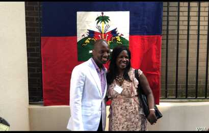 Haiti's Ambassador to the US, Paul Altidor poses for a selfie with one of the Haitian Ladies Brunch attendees, in Washington, Oct. 7, 2018. (Photo: S. Lemaire / VOA)