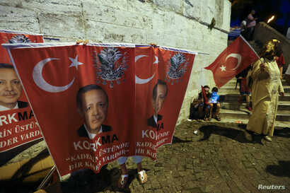 A street vendor sells banners with a photo of Turkish President Tayyip Erdogan in Uskudar district in Istanbul, Turkey, July 21, 2016.