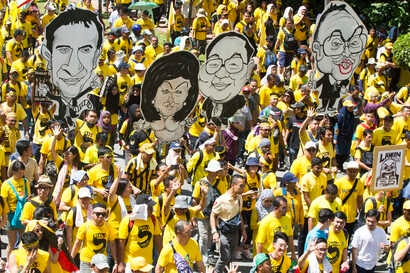 Activists from the Coalition for Clean and Fair Elections (Bersih), march during a rally in Kuala Lumpur, Malaysia, Nov. 19, 2016. Thousands of yellow-shirt protesters rallied Saturday, seeking Prime Minister Najib Razak's resignation over a financia...