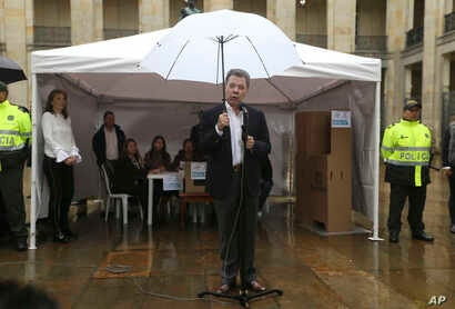 Colombia's President Juan Manuel Santos speaks after after voting in a referendum to decide whether or not to support the peace deal he signed with rebels of the Revolutionary Armed Forces of Colombia, FARC, in Bogota, Colombia, Sunday, Oct. 2, 2016.