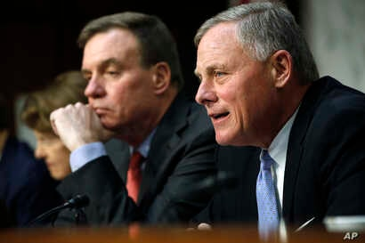 Senate Intelligence Committee chairman Sen. Richard Burr, R-N.C., right, speaks next to Vice Chairman Sen. Mark Warner, D-Va., during a Senate Intelligence Committee hearing on Russian election activity and technology, Wednesday, Nov. 1, 2017, on Cap